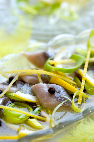 Soused herring with leek, lemon zest and allspice (close-up)