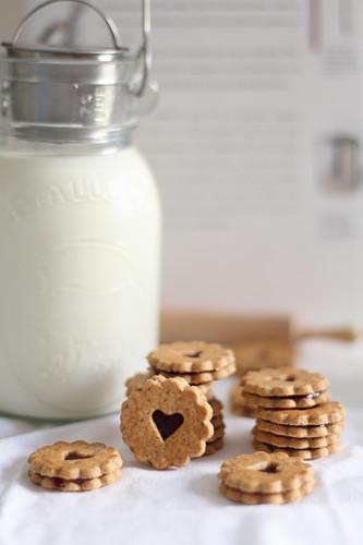 Jam heart cookies beside a milk jug