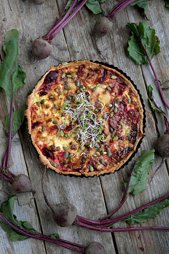 Beetroot quiche with feta cheese and beansprouts (seen from above)