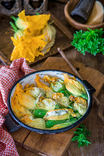 Zucchini flowers stuffed with herbs and cream cheese and baked