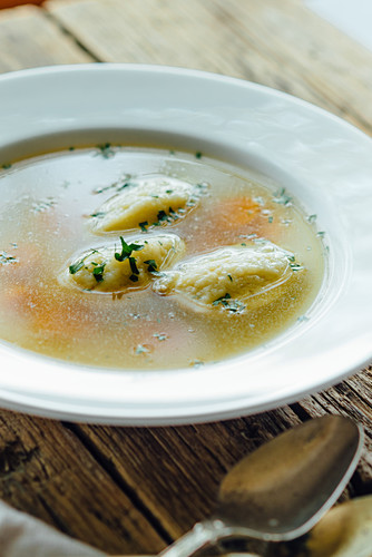 Traditional chicken soup with carrot and dumplings