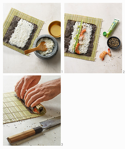Maki with prawns, cucumber and sesame seeds being made