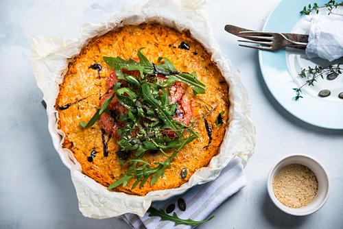 Hokkaido pumpkin gratin with tomatoes and rocket, vegan