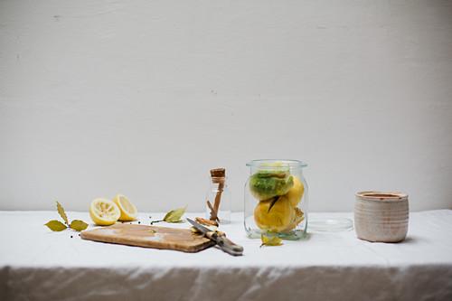 Ingredients for salted lemons (cinnamon, salt, bay leaves, peppercorns) on a light linen cloth