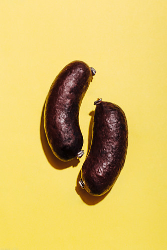 Black pudding on a yellow background