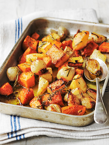 Oven roast winter vegetables with sweet potato pumpkin shallots and carrots with thyme and rosemary