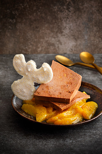 Gingerbread parfait on sliced fruit with a snow angel