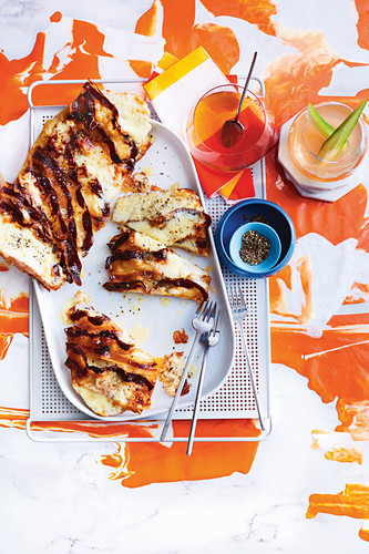 Speck, honey and asiago crostini