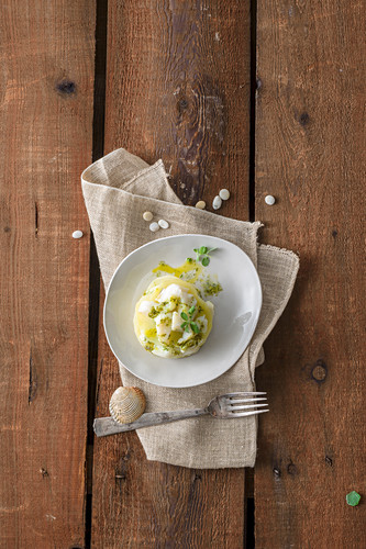 A mini potato and dried cod bake with marjoram sauce