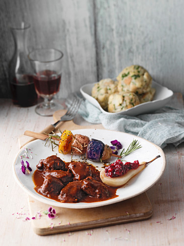 Venison goulash with wild garlic dumplings and a colourful potato skewer