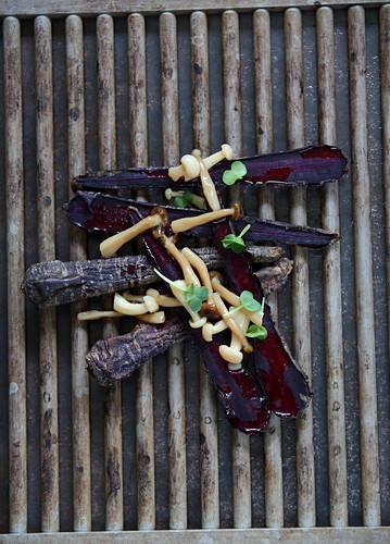 Preserved shimeji mushrooms on roasted ancient carrots