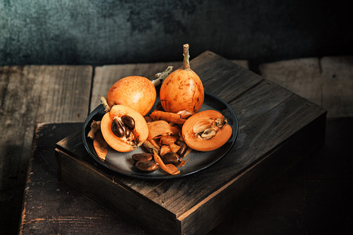 Fresh loquat fruit on rustic table