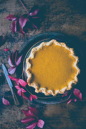 Pumpkin pie on a wooden surface