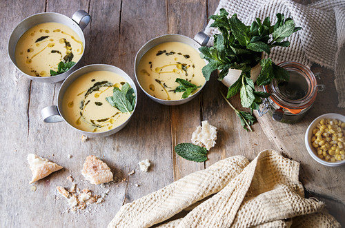 Corn cream soup with coconut and pesto