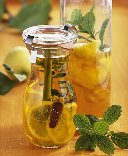 Homemade lemon vinegar with lemon balm
