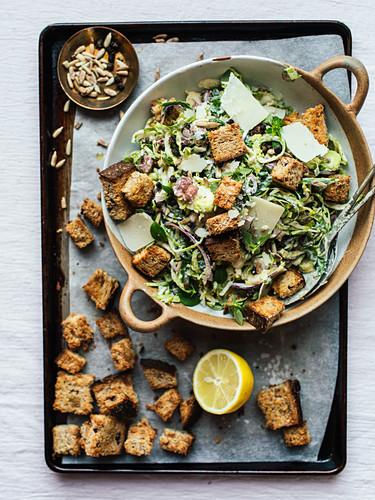 Caesar salad with brussels sprouts and croutons