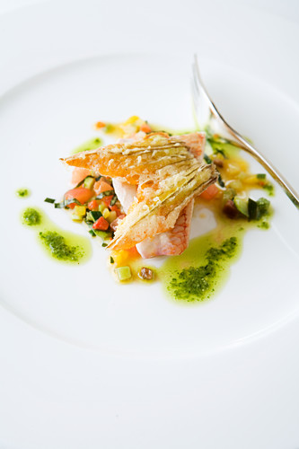 Red mullet on ratatouille vegetables with basil oil