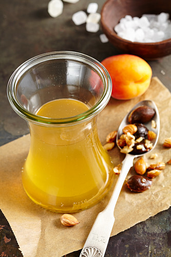 Homemade apricot liqueur with rock sugar and corn schnapps