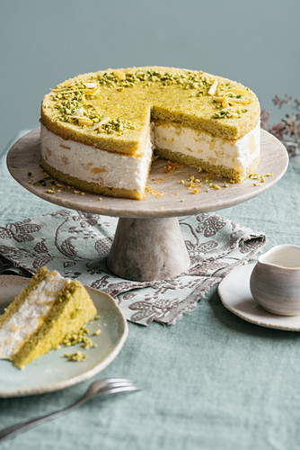 A pistachio cake with cream cheese and caramelised apples