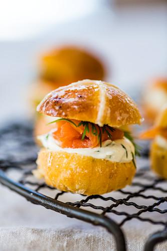 Savoury Hot Cross Bun burger with salmon and cream cheese