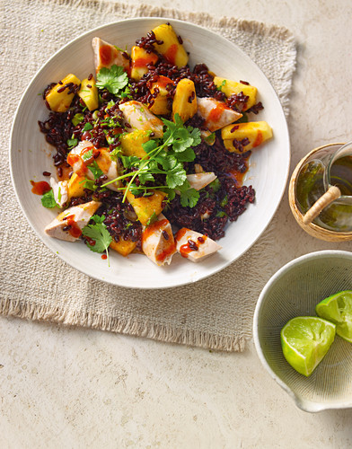 Chicken salad with red rice and pineapple