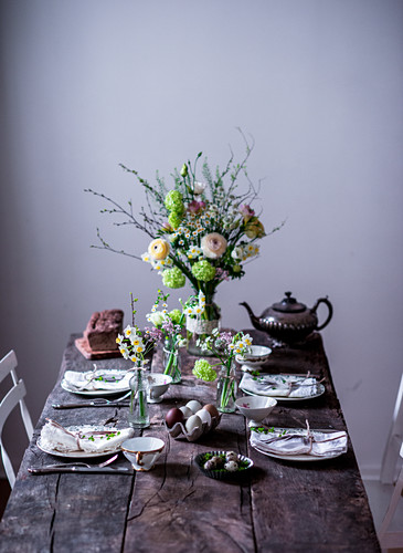 A table laid for Easter with spring flowers