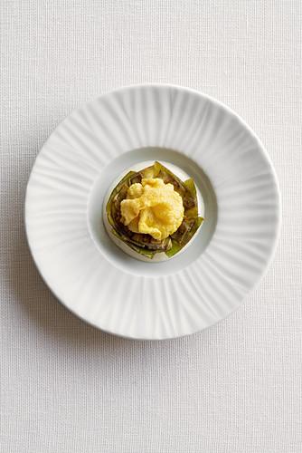 Stuffed artichoke on foam sauce (a dish by Roberto Tonola)
