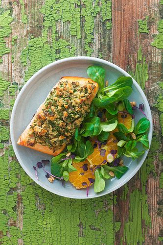 Salmon fillet with herb crust and mixed leaf salad