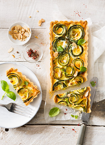 Vegetarian courgette roses and feta cheese quiche with toasted almonds