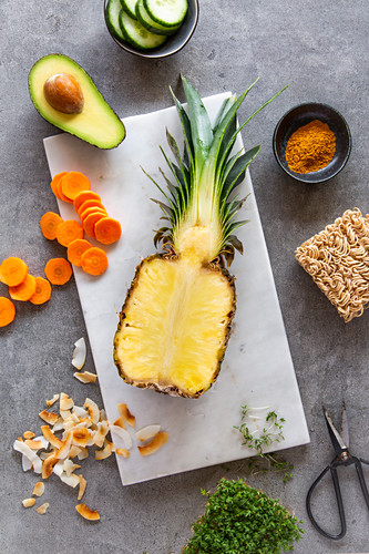 Ingredients for a pineapple bowl with oriental noodles