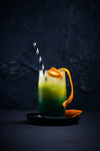 A Green Meadow cocktail (Blue Curaçao and orange juice)