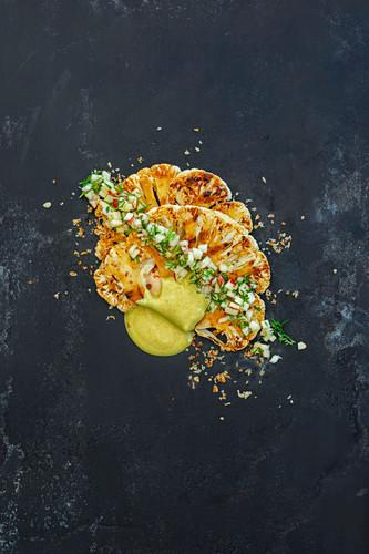 Marinated grilled cauliflower with ajvar and coconut yoghurt and apple salsa (vegan)