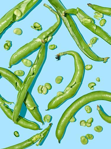 Green beans on a light blue surface
