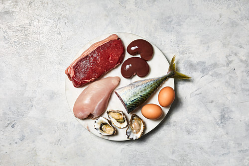 An arrangement of animal products (meat, innards, fish, eggs, oysters and chicken)