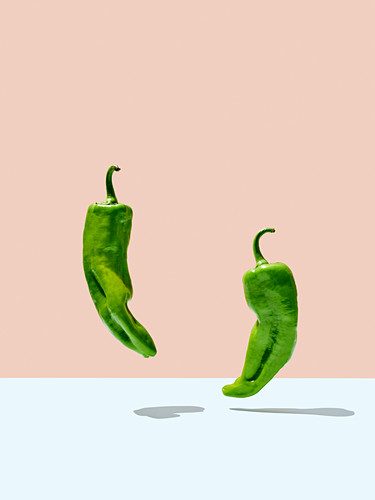 Two green chilli peppers