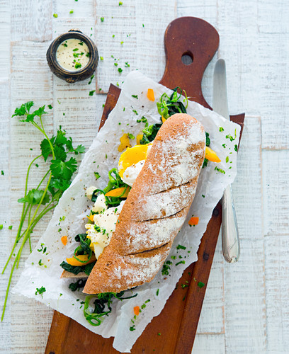 Baguette with spinach and eggs Benedict