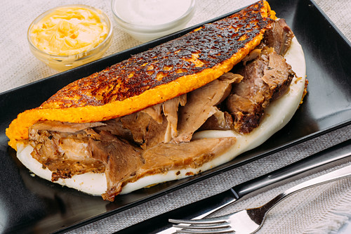 Cachapa (Typical Venezuelan dish made with corn and stuffed with white cheese and pork)