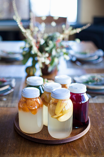 Fermented fruits in glass jars on a table