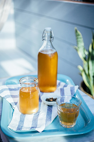 Iced tea with cucumber and lemon on a garden table