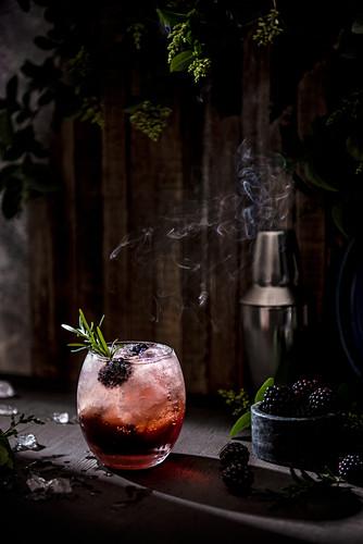 Blackberry bramble cocktail with fresh blackberries
