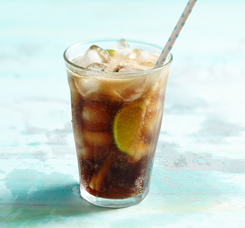 Cuba Libre with lime, rum, coca cola and ice cubes