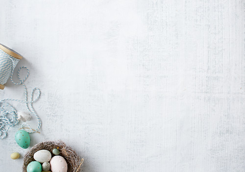 A white fabric background and Easter decoration in the corner