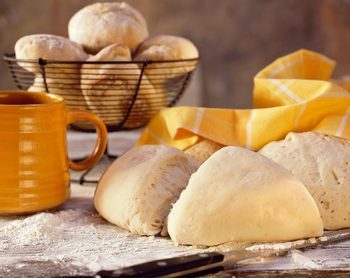 Baking Scene with Bread Dough and Rolls