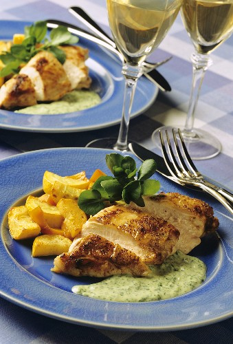 Fried chicken breast fillet with watercress sauce