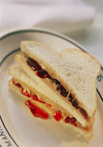 Two Peanut Butter Sandwiches with Assorted Jelly