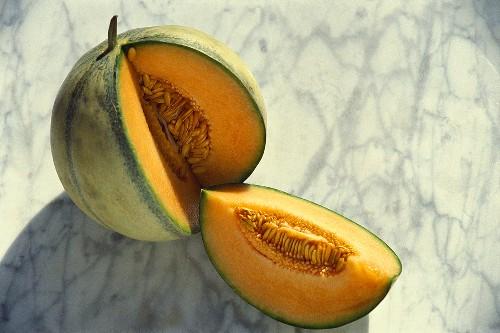 A charentais melon, cut into