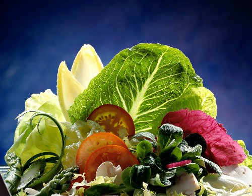 Mixed Greens Salad with Blue Background