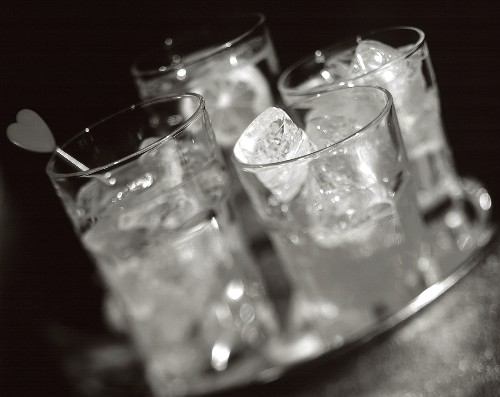 Drinks with ice cubes on a tray (b and w photo)