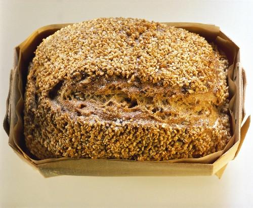Rectangular sesame loaf in wooden mould
