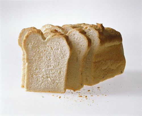 White sandwich bread, one loaf with slices cut